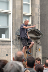 Unicyclist, Royal Mile during the Edinburgh Festival