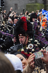 Pipe Band marching down the Royal Mile