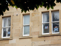 Vote Naw posters in a tenement window
